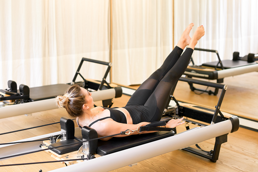 Woman performing the hundred pilates exercise